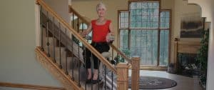 senior woman in red using stair lift