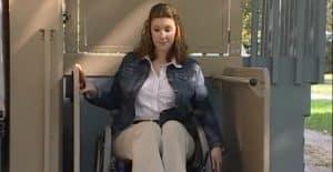 woman on wheelchair using vertical lift
