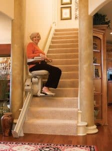 senior woman using indoor stair lift