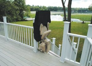 outdoor straight stair lift folded at top of stairs