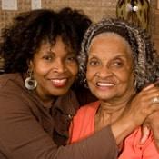 woman with arms around senior woman