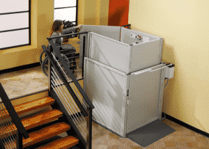 woman in wheelchair using vertical commercial platform lift
