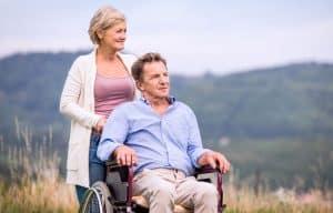 couple outdoor. man on wheelchair