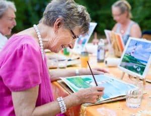senior woman painting activity group