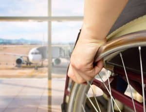 person in wheelchair at airport