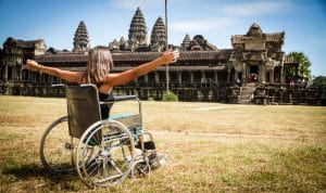 woman in wheelchair infront ancient temple