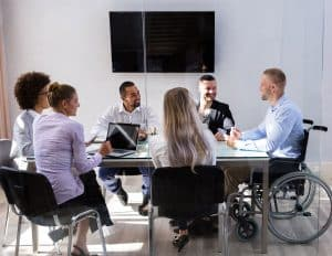man in wheelchair during business meeting