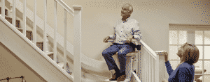 man using stair lift at home