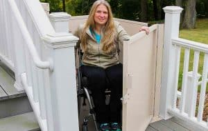 woman in wheelchair using a residential vertical wheelchair platform
