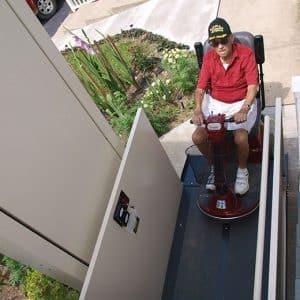 man on scooter using vertical platform lift
